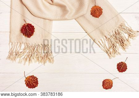Autumn Flat Lay, Red Autumnal Season Leaves Of Aspen Tree, Fabric Scarf On Light Wooden Table With C