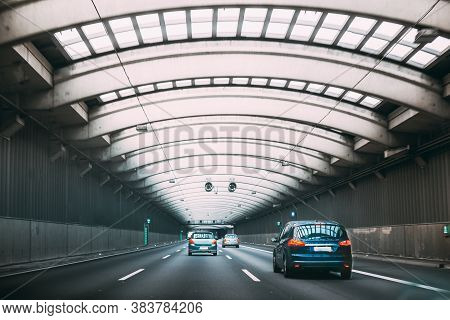 Speeding Cars Traffic Inside A Highway Urban Tunnel.