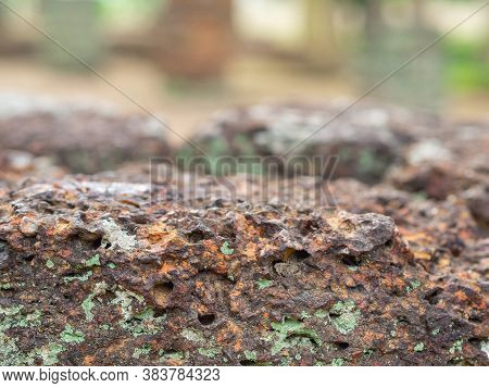 Close-up Of Rough Texture Of Laterite Stone. Abstract Background Of Laterite Stone Wall.