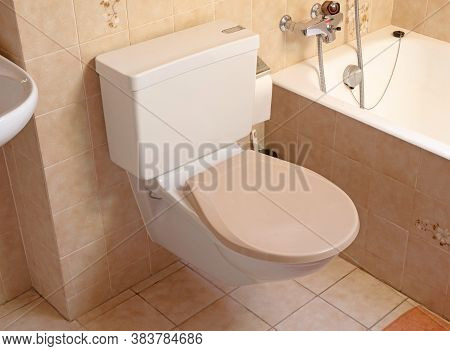 Very Old Toilet In A Brown Bathroom, Empty