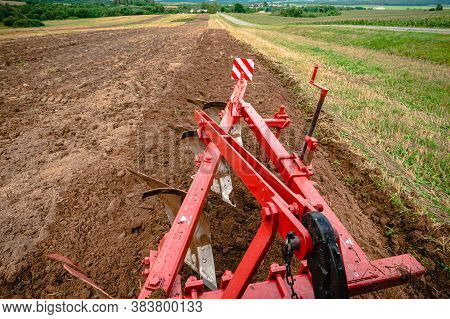 Plow Plowing The Ground Top View From The Tractor Cab, Plow Work Close Up, Plow In The Ground Cuts A
