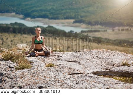 Woman In Lotus Position. Female Meditating On Fresh Air. Sport, Workout Orhealthy Lifestyle Concept.