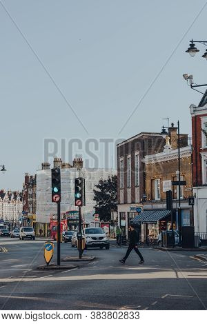 London, Uk - August 20, 2020: Man Crossing Broadway In Crouch End, An Area In North London Tradition