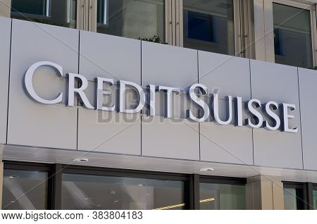 Lugano, Switzerland - 1st September 2020 : Credit Suisse Bank Sign Hanging In Front Of The Building