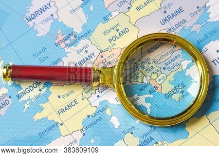 Greece On A Map Of Europe In A Defocused Magnifying Glass, The Theme Of Travel And Trips To Greece,