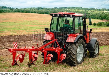 Agricultural Plow For Deep Plowing, Plowing The Field. Large Plow On A Tractor. Tractor With Agricul