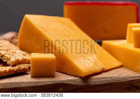 Red Waxed Yellow Cheddar Cheese And Crackers With Grated Cheese