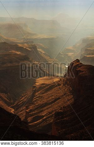 Grand Canyon's Mountains And River Valley Being Lighted By Sunbeams