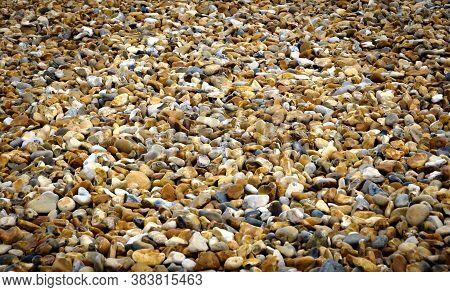 An Empty Pebble Beach On The South Coast Of England. A Random Pattern Of Pebbles. No People. Plenty