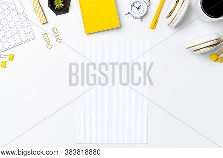 Modern Workspace Background With Grid Paper Sheet. Neat Office Desk Or Home Table With Stationary An
