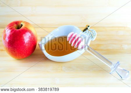 Jewish Holiday Rosh Hashana Background With Honey And Apple On Wooden Table. During The Jewish New Y