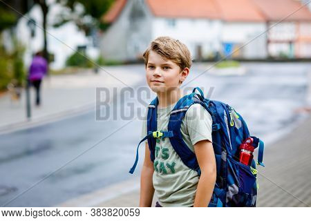 Happy Little Kid Boy With Backpack Or Satchel. Schoolkid On The Way To Middle Or High School. Health