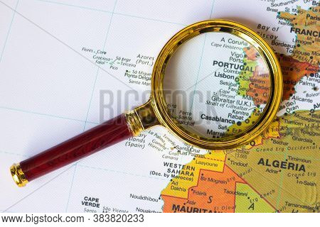 Portugal  And Other Countries On A Map Of Europe  In A Defocused Magnifying Glass, The Theme Of Trav