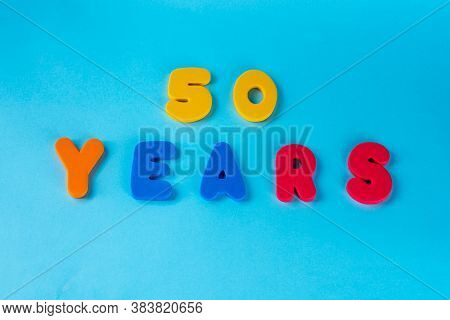 50 Years Old Celebrating Classic Logo. Colored Happy Anniversary 50 Th Colored Numbers On Blue Backg