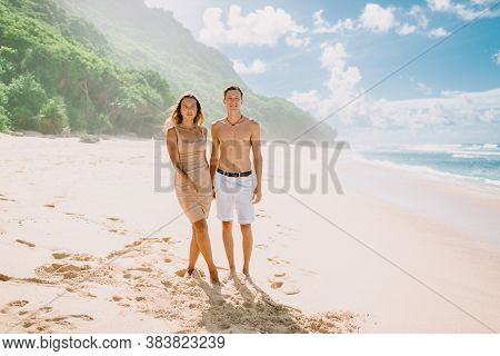 January 28, 2020. Bali, Indonesia. Young Happy Couple At Tropical Beach With Blue Ocean. Love Story