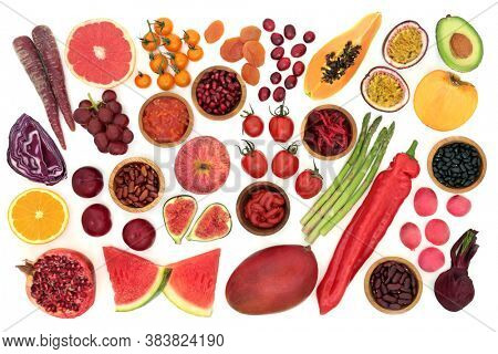 Immune boosting health food high in lycopene with a collection of fruit & vegetables. Foods also very high in antioxidants, dietary fibre, anthocyanins, minerals & vitamins & dietary fibre. Top view.