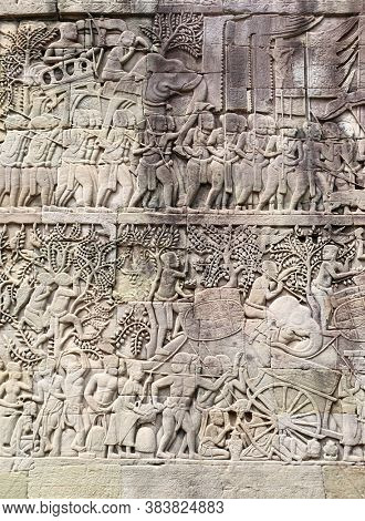 Wall carving with depicting troops, soldiers and military leaders on elephants in Prasat Bayon Temple, in famous Angkor Wat complex, khmer culture, Siem Reap, Cambodia. UNESCO world heritage site