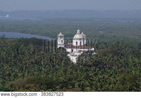 OLD GOA, INDIA - FEBRUARY 18, 2020: Old Goa, Mandovi River and Church of St Cajetan, Goa, India