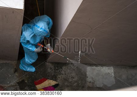 Frontline Worker Sanitizing Or Disinfecting Galli, Alley Or Alleyway Due To Covid-19 Or Coronavirus