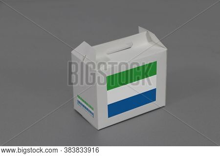 Sierra Leonean Flag On White Box With Barcode And The Color Of Nation Flag On Grey Background. The C
