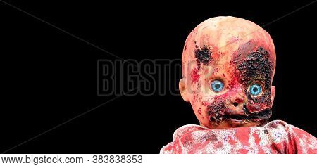 Creepy bloody doll Halloween concept, Close up of children Ghost mystic doll, Scary horror doll face