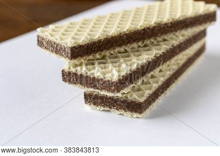Several Wafers With Chocolate On A Light Background. Selective Focus.