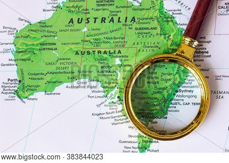Australia  On A Map In A Defocused Magnifying Glass, The Theme Of Travel And Trips To Australia Sydn