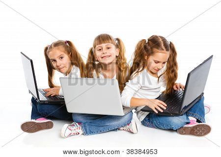 Three attractive girl using a laptop