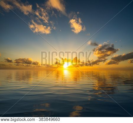 Dramatic Sunrise Or Sunset Reflected Into The Calm Waters Of An Artificial Ocean To Represent Peace