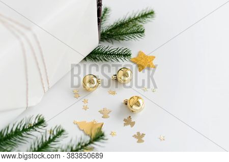 New Year Gift Wrapping With Gold Decoration. Balls, Stars And Tree Branches. Christmas Gifts, Prepar