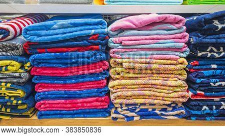 Many Colourful Beach Towels Stuck At Shelf