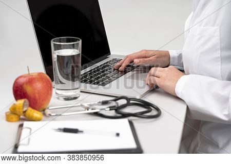 Nutritionist desk with healthy food . Gray back ground.