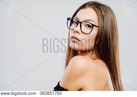 Beautiful woman model waring eye glasses posing in studio