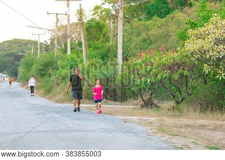 Kanchanaburi/thailand-may 7,2020 : Unidentified Thai Sportive People Jogging For Good Health On Road