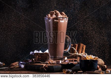 Glass Of Hot Chocolate Cocoa Drink Sprinkled With Cocoa Powder. Dark Background. Winter Food And Dri
