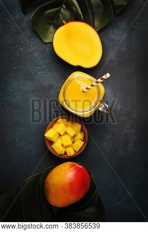 Freshly Squeezed Fresh Mango Juice In Large Glass Jar With Fresh Fruit On Dark Blue Background, Plac