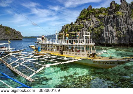 Philippines, Palawan, Coron Island, December, 2019 - Pleasure Boats With Tourists Sailed To A Beauti