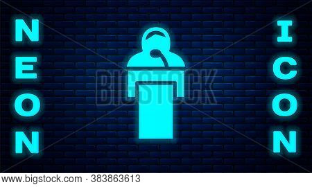 Glowing Neon Gives Lecture Icon Isolated On Brick Wall Background. Stand Near Podium. Speak Into Mic