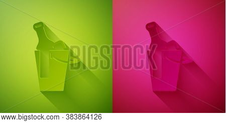 Paper Cut Bottle Of Wine In An Ice Bucket Icon Isolated On Green And Pink Background. Paper Art Styl