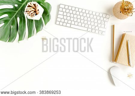Female Office Desk Workspace With Computer, Tropical Palm Leaves Monstera, Accessories On White Back