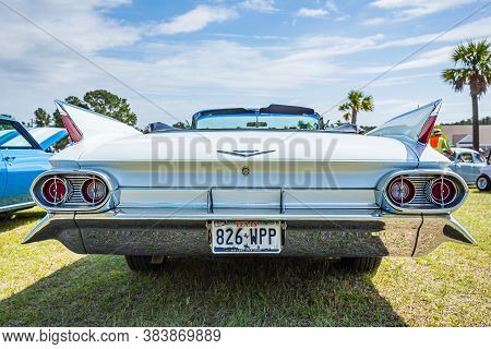 Savannah, Ga / Usa - April 21, 2018: 1961 Cadillac Series 62 Convertible At A Car Show In Savannah,