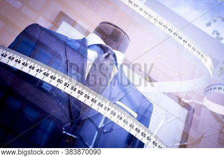 Mannequin In A Mens Suit Surrounded By A Tailors Tape Measure. No People
