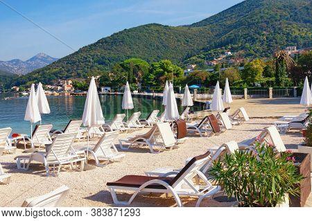 Beach Vacation.  Beautiful Mediterranean Landscape With Beach Umbrellas On Sunny Autumn Day. Montene