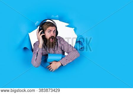 Education Online. Online Business Course. His Favorite Song. Cheerful Man Wear Modern Earphones. Mal