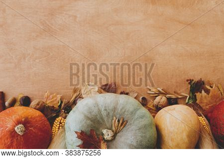 Happy Thanksgiving Flat Lay With Space For Text. Pumpkins, Autumn Leaves, Nuts And Spices On Rustic