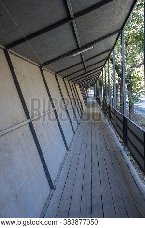 Covered Wooden Passageway For Pedestrians Near The Construction Site, Safety Of Movement Of People.