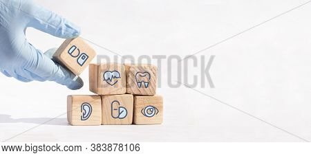 Health Insurance Concept, Arranging Wood Block Stacking With Icon Healthcare Medical.