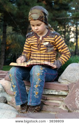 Girl Sitting And Reading