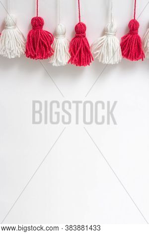 Brushes From Yarn Of Red And White Color On A White Background. Space For Copy Space. Diy Yarn Brush