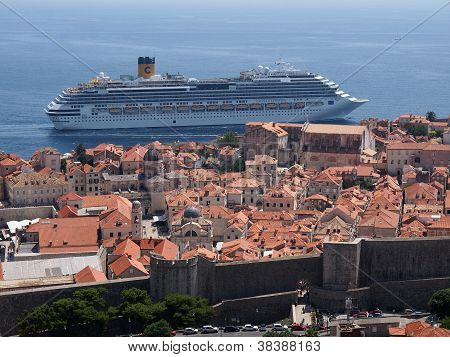 Dubrovnik, Croatia - July 16: The Costa Favolosa Cruise Ship Passes Very Close To The Old Town Walls